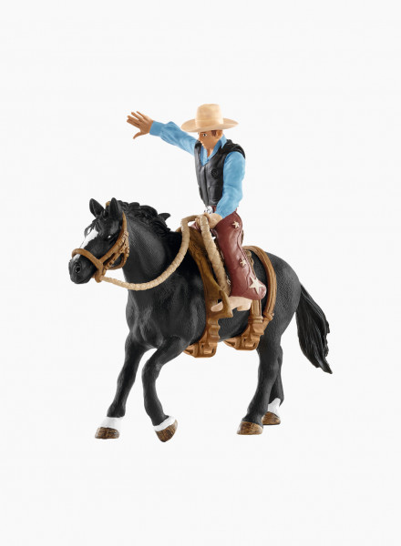 "Figurine ""Saddle bronc riding with"""